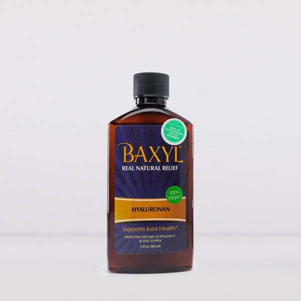 Brown plastic bottle of baxyl with blue and orange label